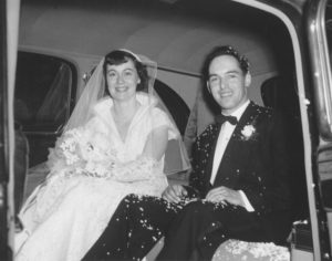 My grandparents in their wedding limo with confetti.