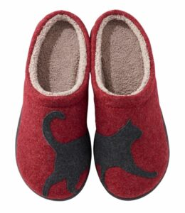 Cute women's cat slippers in red with a black cat spanning both slippers and cream sherpa lining.