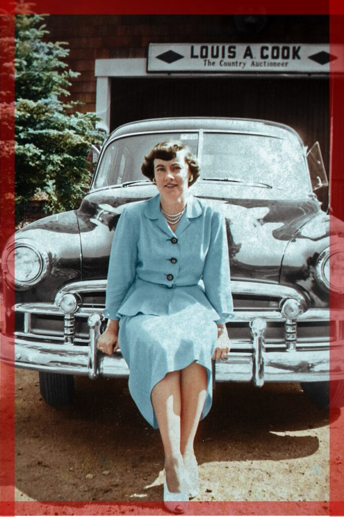 "Photo of a medium-format image of a woman sitting in a baby blue dress on the front of a 1950s car in front of a sign reading ""LOUIS A. COOK — The Country Auctioneer."" with red borders around it to demonstrate cropping."
