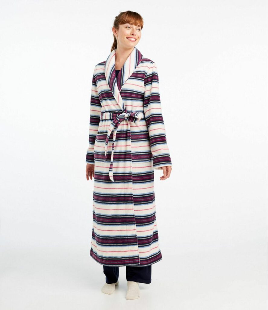 Woman smiling in a striped bathrobe.