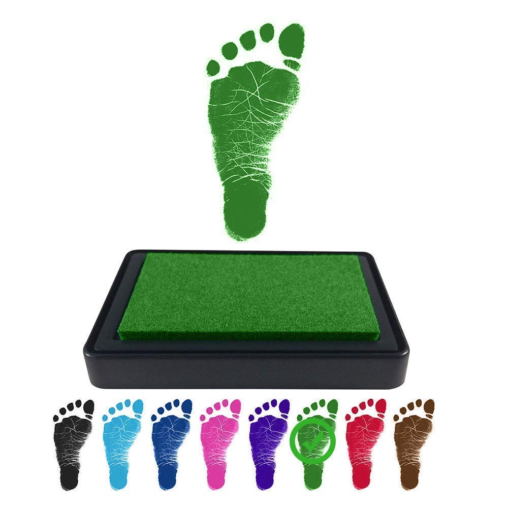 Green baby's foot with ink pad and several other example colors in black, blue, magenta, red, and brown.