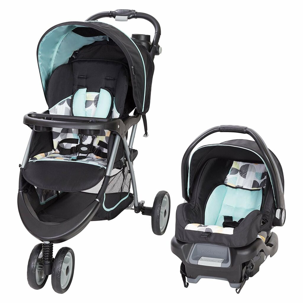 Stroller with car seat combo. Stroller has two wheels on the front. Both have a shade.