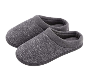 A cozy, slip-on women's slipper in grey with black rubber bottoms.