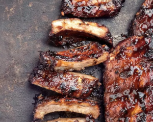 Photo of delicious BBQ ribs slathered in BBQ sauce.