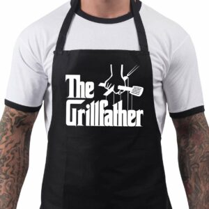"Man wearing an apron reading ""The Grillfather"" using the style of the movie ""The Godfather."""