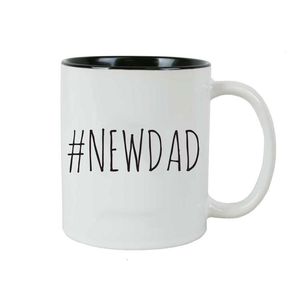 "White mug with black interior reading in black text, ""#NEWDAD"""