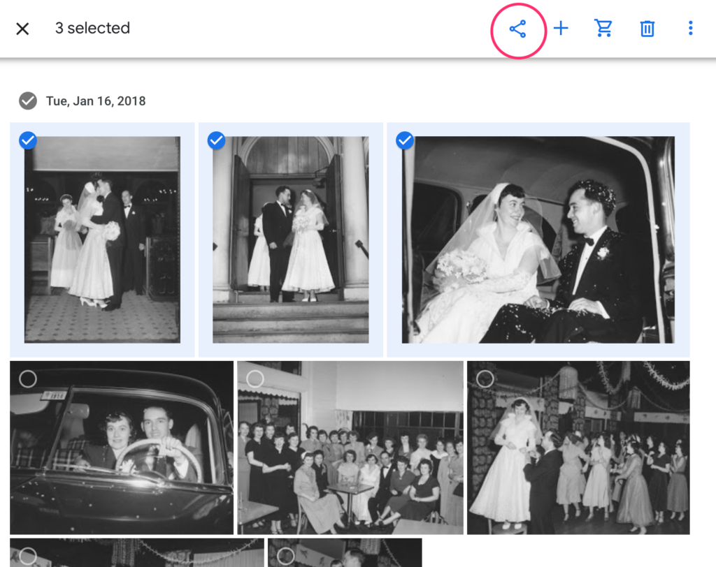 """The Google Photos interface showing several black and white photos. Three of them are checked off. In the top is a menu, the share icon is circled in red for emphasis. There are other buttons: """"+"""", a shopping cart, and trash can."""