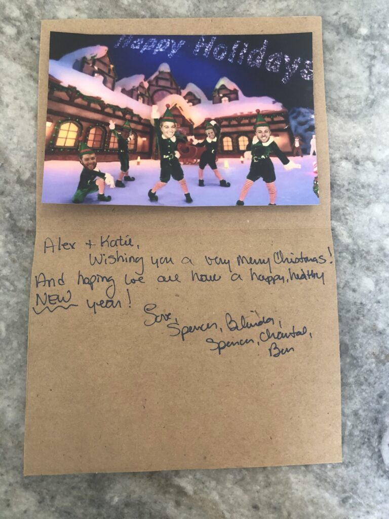 Inside of the card featuring a photo of the family and a personal message