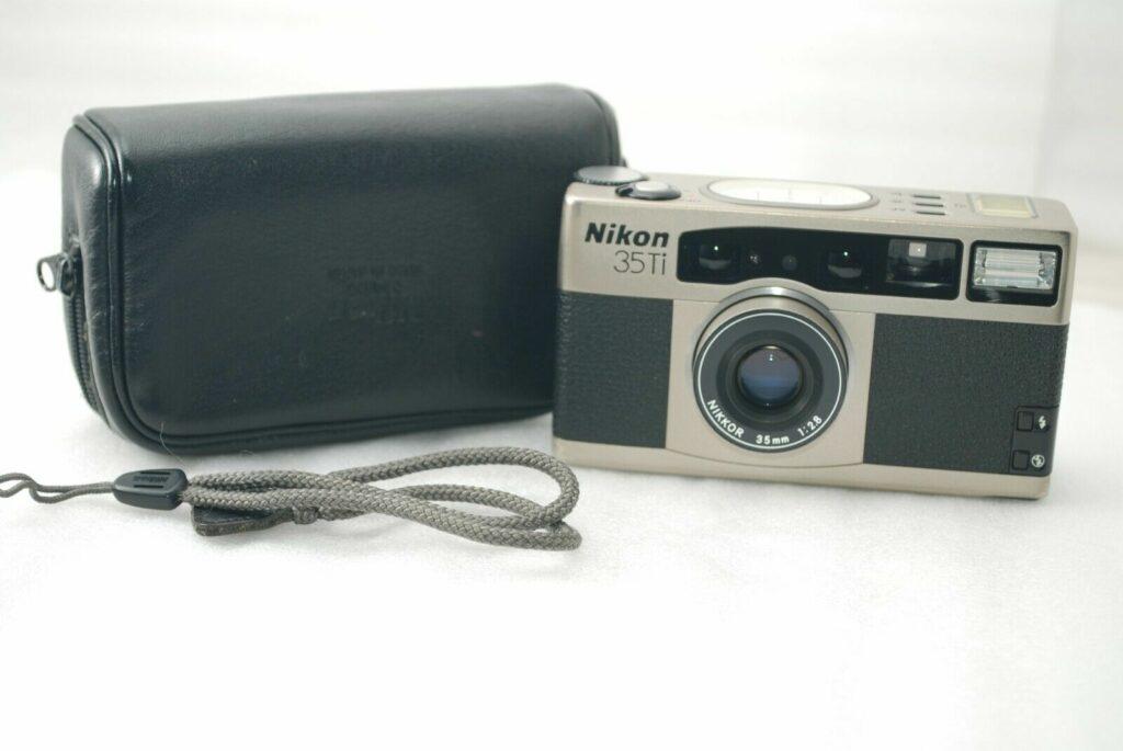 Nikon 35TI Camera (Right) and leather back (left).