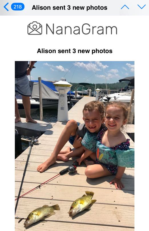 Screen shot of Apple iPhone email showing the subject 'Alison sent 3 new photos' with the body of the email being a NanaGram logo and a photo of two kids (fishing in the previous photo) with two big small-mouth bass caught and displayed on the dock.
